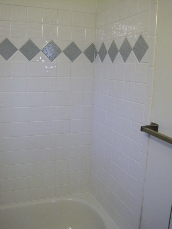 Guest Bath tub (gray tiles are same tiles as on floor.)