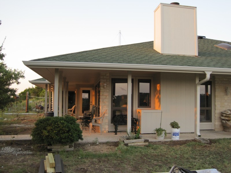 Hardie siding, new gutters, note chimney no longer has 2x4s to keep siding up.