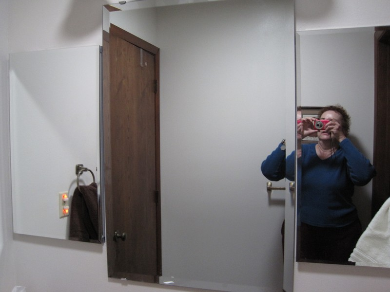 The three mirrors over the sink area