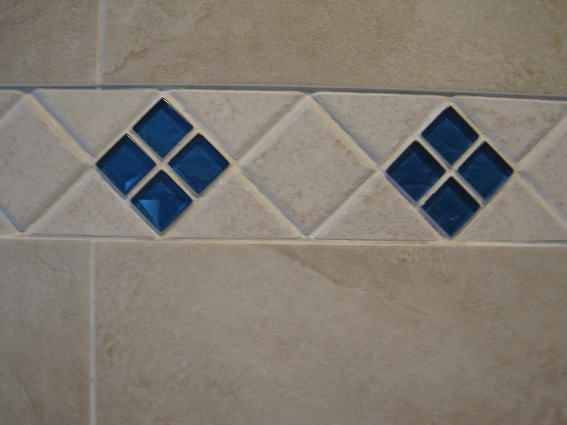 Wall tile accent pattern.  Blue tiles are glass with foil backs.