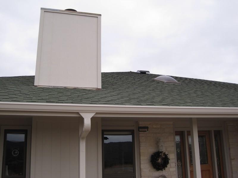 You can see solar attic vent near peak